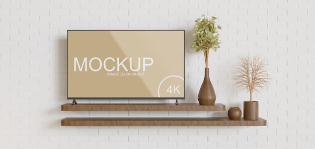 Tv-mockup op het vooraanzicht van de minimalistische houten wandtafel