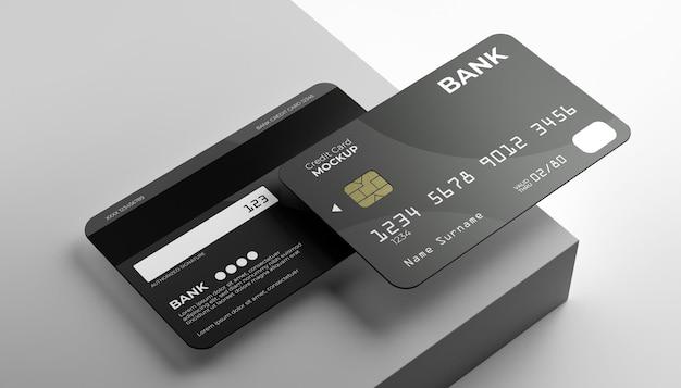 Twee creditcard mock-up met podium achtergrond.