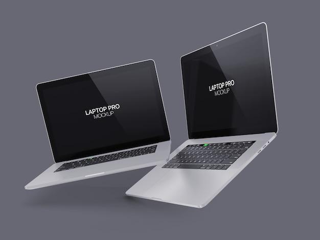 Twee drijvende laptop mockup laptop