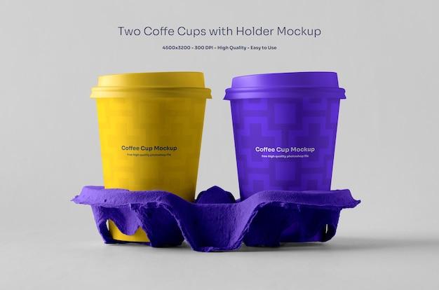 Twee koffiekopjes op houdermodel