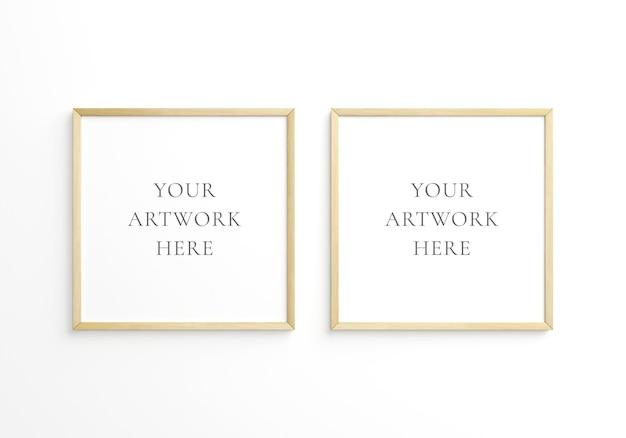 Twee vierkante dunne houten frame op witte muur. 3d-rendering.