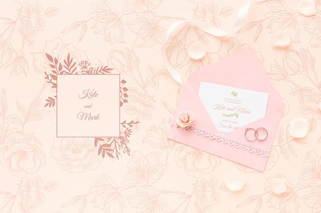 Uitnodiging mock-up en trouwringen