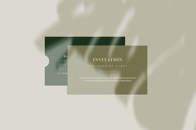 Uitnodigingskaart en envelop met plant schaduw