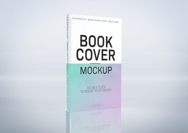 Un mockup di una copertina di libro sulla superficie grigia