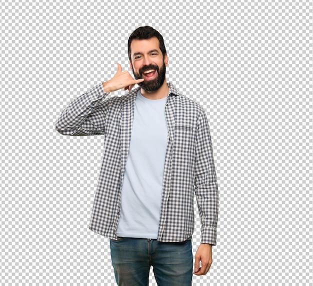 Uomo bello con la barba che fa gesto del telefono. richiamami segno