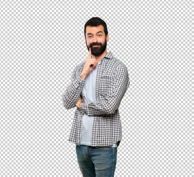 Uomo bello con la barba che sembra anteriore