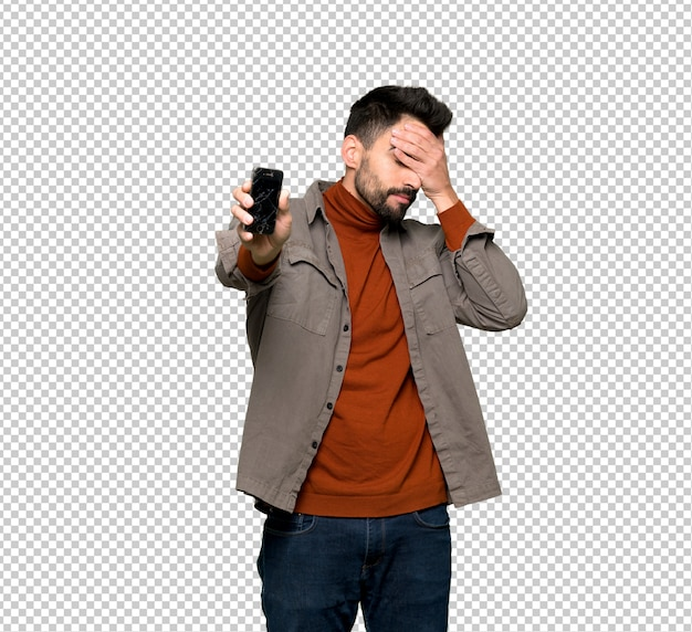 Uomo bello con la barba con lo smartphone rotto azienda disturbata