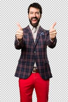 Uomo ben vestito con il pollice in su