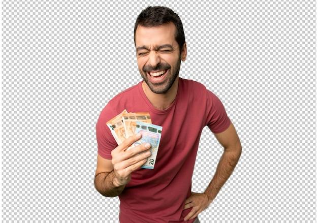 Uomo che prende molti soldi felici e sorridenti