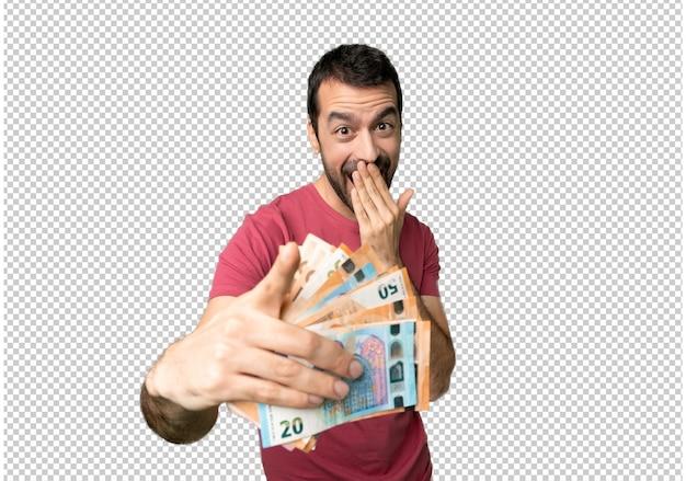 Uomo che prende un sacco di soldi che puntava il dito contro qualcuno e ridendo
