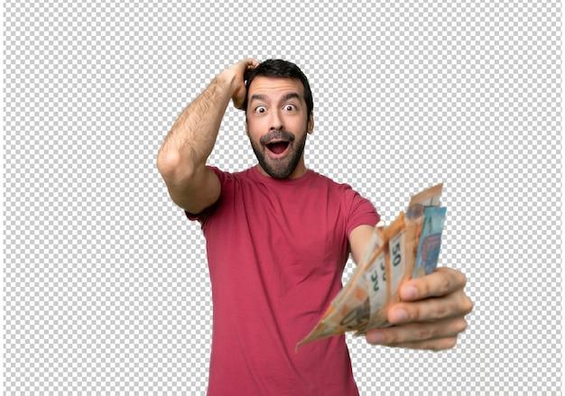 Uomo che prende un sacco di soldi con espressione facciale sorpresa e scioccata
