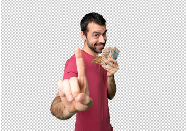 Uomo che prende un sacco di soldi mostrando e alzando un dito