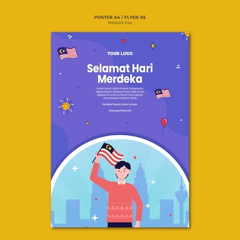 Uomo che tiene il modello del manifesto della bandiera malese