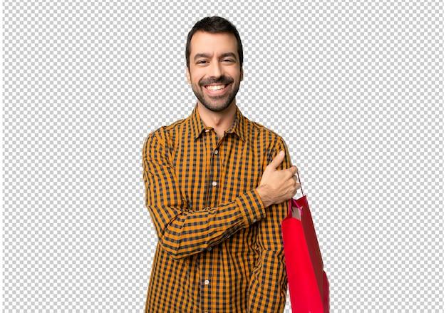 Uomo con borse della spesa con espressione felice