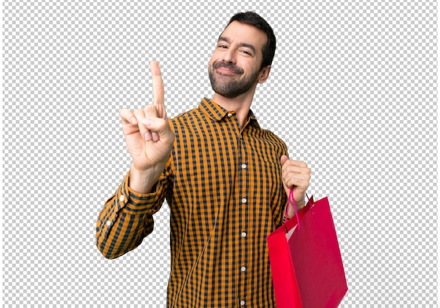 Uomo con borse della spesa mostrando e alzando un dito nel segno del meglio