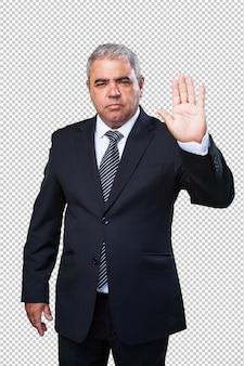 Uomo di affari che fa un gesto di arresto