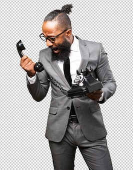 Uomo di colore di affari che tiene un telefono