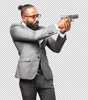 Uomo di colore di affari che tiene una pistola