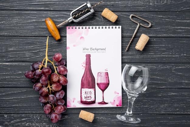 Uvas y cuaderno