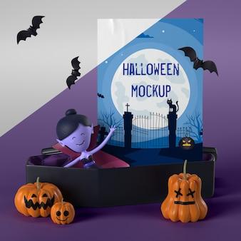 Vampiro en ataúd junto a maqueta de tarjeta de halloween