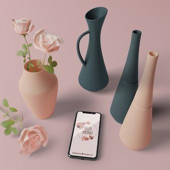 Vasi 3d con fiori accanto al cellulare