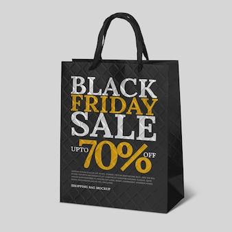 Ventas de viernes negro con maqueta de bolsa de compras.