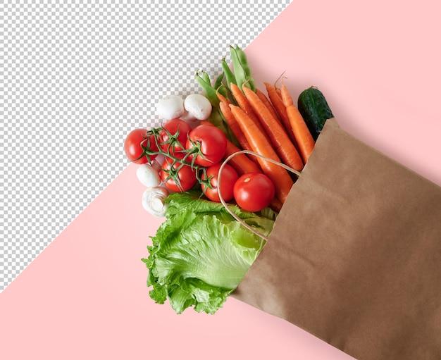 Verse groenten in recyclebare papieren zak op roze achtergrond met kopieerruimte