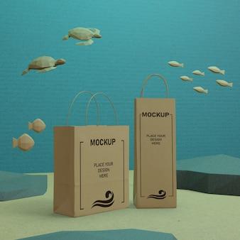 Vida marina día del océano y bolsas de papel bajo el agua con maqueta