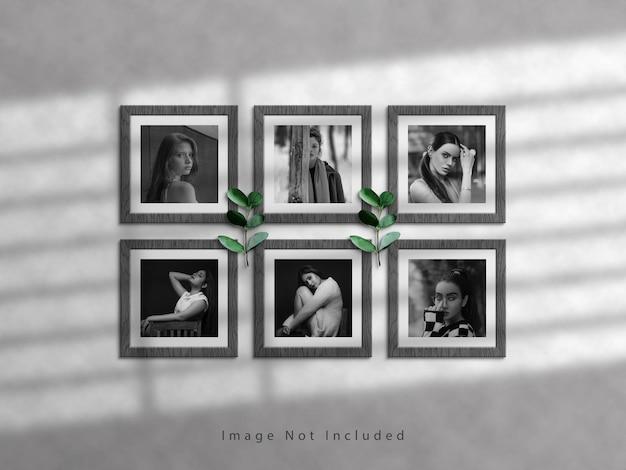 Vierkant fotolijstmodel op witte muur en schaduwoverlay