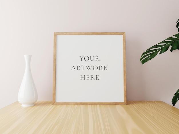 Vierkant houten frame mockup op houten tafel met vaas en planten. 3d-rendering.