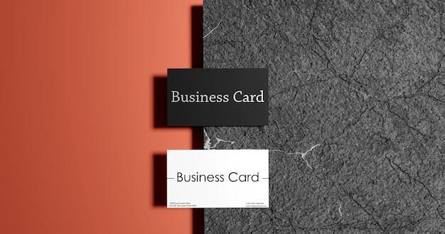 Visitekaartje mock-ups op zwarte marmeren achtergrond.