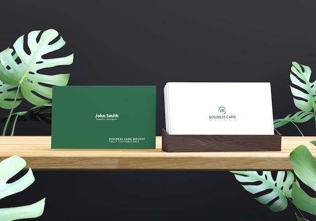 Visitekaartje mockup met gebladerte ontwerp