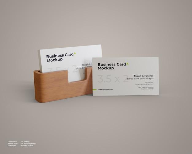 Visitekaartje mockup met houten houder
