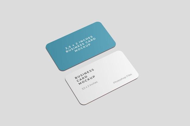 Vista de ángulo alto de maqueta de tarjeta de visita redondeada