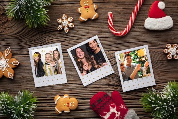 Vista dall'alto foto di famiglia e bastoncini di zucchero candito