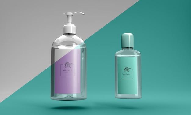 Vista frontal de botellas de maquetas desinfectantes para manos