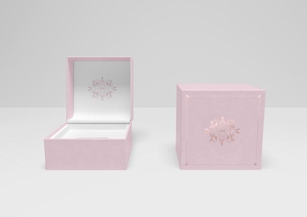 Vista frontal de cajas de joyas rosas