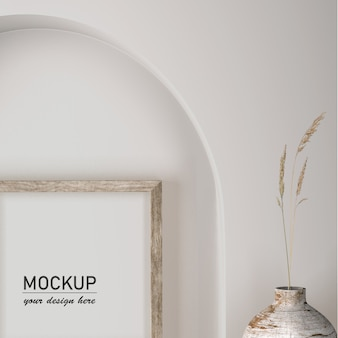 Vista frontal de la decoración de la pared con jarrón y marco