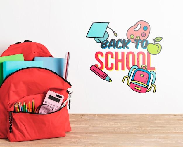 Vista frontal mochila con útiles escolares