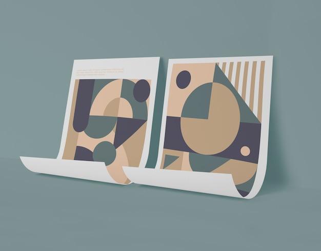Vista frontal de papeles de maquetas con formas geométricas.