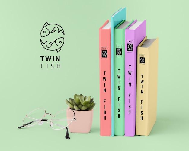 Vista frontal pila de maquetas de diferentes portadas de libros