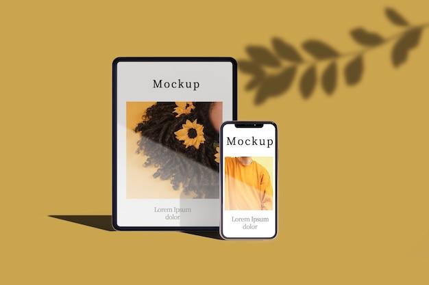 Vista frontal de la tableta y el teléfono inteligente con hojas de sombra