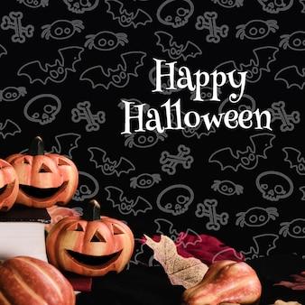 Vista frontale delle zucche di halloween con fondo nero