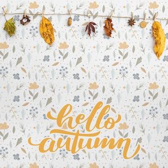 Vista frontale di ciao autunno e foglie