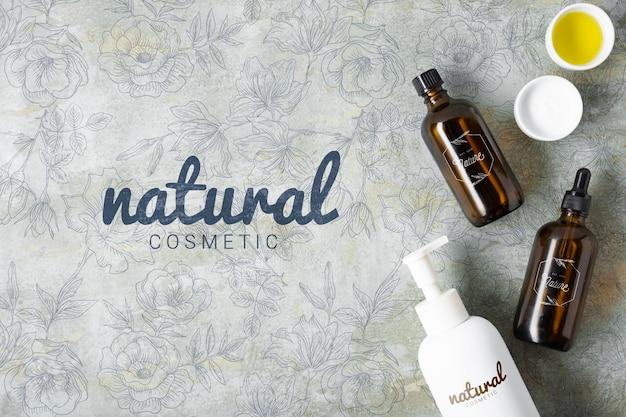 Vista superior de la botella de aceite esencial para el cuidado de la piel natural