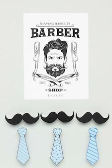 Vista superior del cartel de barbería con maqueta