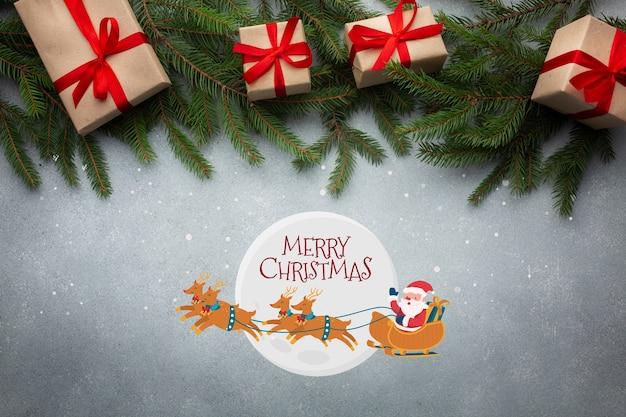 Vista superior feliz navidad y hojas de pino de navidad