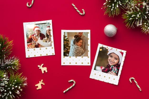 Vista superior de fotos familiares sobre fondo rojo