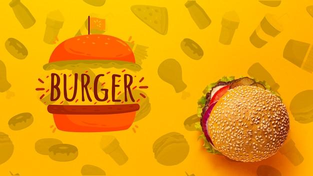 Vista superior hamburguesa sobre fondo de comida rápida doodle