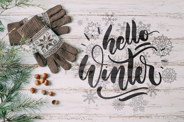 Vista superior hola invierno con guantes calientes